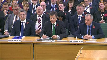 Andrew Parker the head of M15, John Sawers the head of M16 and Iain Lobban GCHQ director (L-R) are seen attending an Intelligence and Security Committee hearing at Parliament, in this still image taken from video in London November 7, 2013. REUTERS/UK Parliament via REUTERS TV