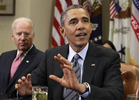 U.S. President Barack Obama (R) speaks next to Vice President Joe Biden during a meeting with business leaders to discuss immigration at the White House in Washington November 5, 2013. REUTERS/Yuri Gripas