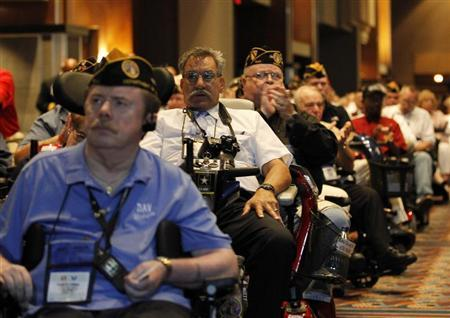 Disabled U.S. military veterans listen to President Barack Obama at the National Convention of Disabled American Veterans in Atlanta, August 2, 2010. REUTERS/Jason Reed