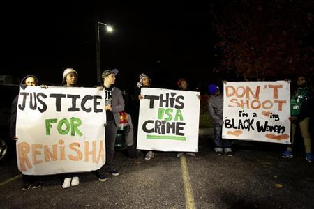 Demonstrators protest against the killing of 19-year-old Renisha McBride outside the Dearborn Heights Police Station in Dearborn Heights, Michigan November 7, 2013. REUTERS/Joshua Lott