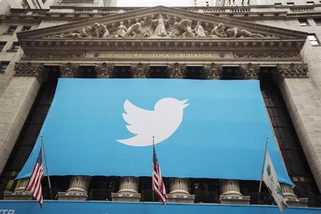 A sign displays the Twitter logo on the front of the New York Stock Exchange ahead of the company's IPO in New York, November 7, 2013. REUTERS/Lucas Jackson