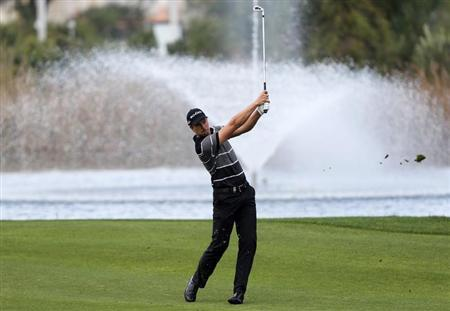 Henrik Stenson of Sweden plays a shot on the fifth hole during the first round of the inaugural Turkish Airlines Open in the south west city of Antalya November 7, 2013. REUTERS/Umit Bektas