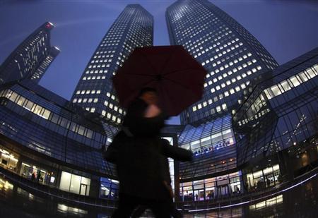 A pedestrian walks past the headquarters of Deutsche Bank in Frankfurt February 24, 2011. REUTERS/Ralph Orlowski