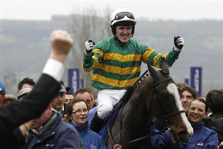 Tony McCoy on Synchronised celebrates as he enters the unsaddling enclosure after winning The Gold Cup at the Cheltenham Festival horse racing meet in Gloucestershire, western England March 16, 2012. REUTERS/Stefan Wermuth