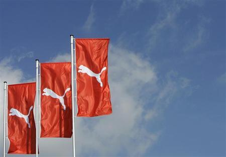 Flages wave over the Puma factory outlet store in Herzogenaurach near Nuremberg April 10, 2007. REUTERS/Michaela Rehle (GERMANY) - RTR1OHKA