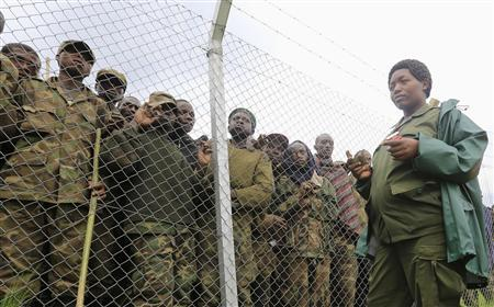 An army officer stands guards outside an enclosure filled with M23 rebel fighters who have surrendered to Uganda's government at Rugwerero village in Kisoro district, 489km (293 miles) west from Uganda capital Kampala November 8, 2013. REUTERS/James Akena