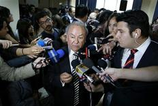 Rodolfo Reyes, nephew of Chilean poet and Nobel laureate Pablo Neruda, talks to the media after a news conference in Santiago November 8, 2013. REUTERS/Ivan Alvarado
