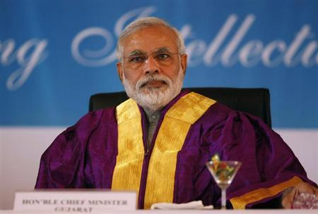 Gujarat's chief minister and Hindu nationalist Narendra Modi, the prime ministerial candidate for opposition Bharatiya Janata Party (BJP) attends a convocation ceremony at Pandit Deendayal Petroleum University (PDPU), a school of petroleum management, at Gandhinagar in Gujarat October 19, 2013. REUTERS/Amit Dave/Files