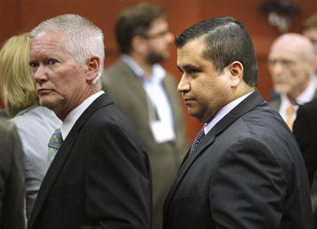 George Zimmerman is escorted from the courtroom a free man after being found not guilty in the 2012 shooting death of Trayvon Martin at the Seminole County Criminal Justice Center in Sanford, Florida, July 13, 2013. REUTERS/Joe Burbank/Pool