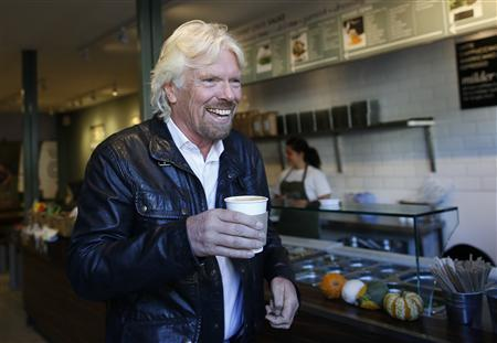 Sir Richard Branson, Founder of Virgin Group, buys a coffee before a seminar about the Virgin StartUp scheme for young entrepreneurs at Box Park in east London, October 24, 2013. REUTERS/Olivia Harris