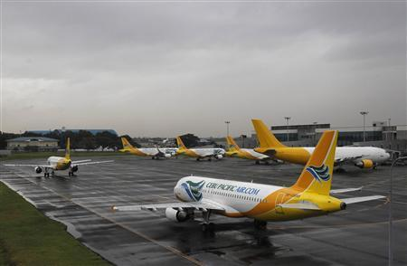 Cebu Pacific airways planes park at the tarmac at Ninoy Aquino International airport in Pasay city, metro Manila November 8, 2013, after nearly 200 local flights have been suspended due to Typhoon Haiyan that hit central Philippines on Friday. REUTERS/Romeo Ranoco
