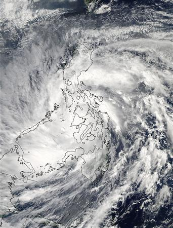 Super-Typhoon Haiyan moves over the central Philippines in this NASA satellite image taken at 05:10 GMT/12:10 a.m. EDT November 8, 2013. REUTERS/NASA/Handout via Reuters