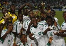 Nigeria's team players celebrate winning their U-17 World Cup UAE final soccer match against Mexico at Mohammed Bin Zayed Stadium in Abu Dhabi November 8, 2013. REUTERS/Ahmed Jadallah