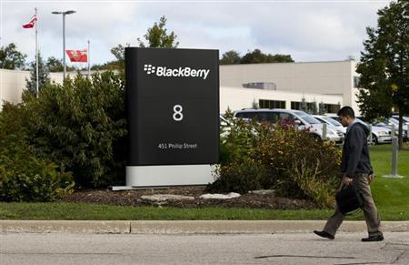 A man walks through a driveway at the Blackberry campus in Waterloo, September 23, 2013. REUTERS/Mark Blinch