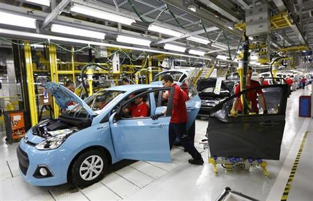 Workers assemble a new Hyundai i10 car at the Hyundai Assan car plant in Izmit, western Turkey, September 26, 2013. REUTERS/Murad Sezer