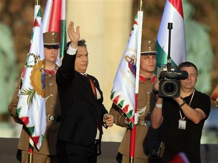 Hungarian Prime Minister Viktor Orban waves after his speech at the Heroes Square in Budapest, October 23, 2013, as Hungary commemorates the 57th anniversary of their revolution against Soviet rule. REUTERS/Bernadett Szabo