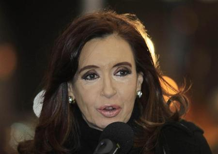 Argentina's President Cristina Fernandez de Kirchner speaks after arriving at the Silvio Pettirossi airport in Asuncion August 14, 2013. De Kirchner is in Paraguay to attend Thursday's inauguration of Paraguayan President-Elect Horacio Cartes. REUTERS/Jorge Adorno