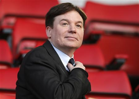 Actor Mike Myers sits in the stands before Liverpool faces Fulham in their English Premier League soccer match at Anfield in Liverpool, northern England November 9, 2013. REUTERS/Phil Noble
