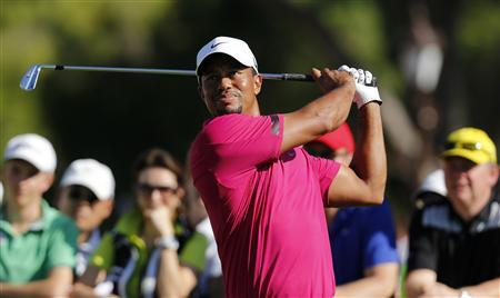 Tiger Woods of the U.S. tees off on the 10th hole during the third round of the inaugural Turkish Airlines Open in the southwest city of Antalya November 9, 2013. REUTERS/Umit Bektas