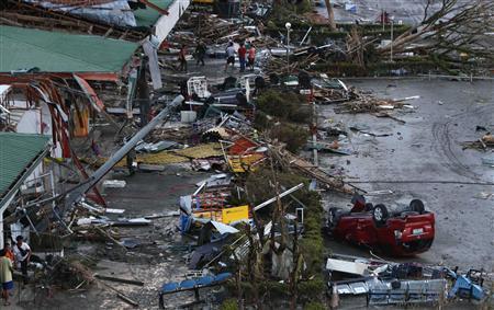 Debris litter a damaged airport after super Typhoon Haiyan battered Tacloban city in central Philippines November 9, 2013. REUTERS-Erik De Castro