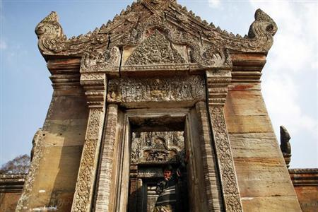A Cambodian soldier smokes a cigarette at the 11th-century Preah Vihear temple on the border between Thailand and Cambodia February 9, 2011. REUTERS/Damir Sagolj