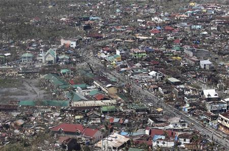 An aerial view shows damaged houses brought by Typhoon Haiyan in the province of Leyte, central Philippines November 10, 2013. REUTERS/Ryan Lim/Malacanang Photo Bureau/Handout via Reuters