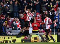 Sunderland's Phil Bardsley (L) celebrates scoring against Manchester City during their English Premier League soccer match at The Stadium of Light in Sunderland, northern England, November 10, 2013. REUTERS/Nigel Roddis