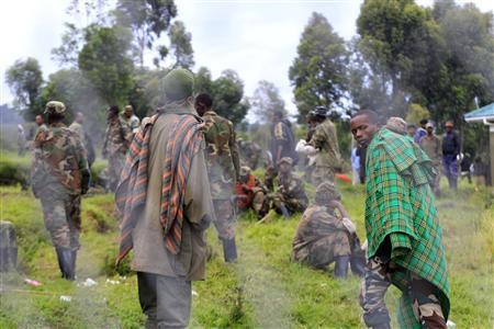Congolese M23 rebels walk inside an enclosure after surrendering to Uganda's government at Rugwerero village in Kisoro district, 489km (293 miles) west from Uganda capital Kampala November 8, 2013. REUTERS/James Akena