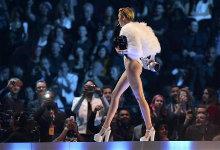Singer Miley Cyrus walks on stage during the 2013 MTV Europe Music Awards at the Ziggo Dome in Amsterdam November 10, 2013. REUTERS/Remko De Waal