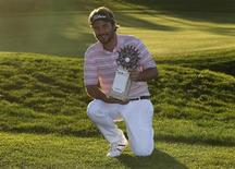 Victor Dubuisson of France poses with his trophy after his victory at the inaugural Turkish Airlines Open in the south west city of Antalya November 10, 2013. REUTERS/Umit Bektas