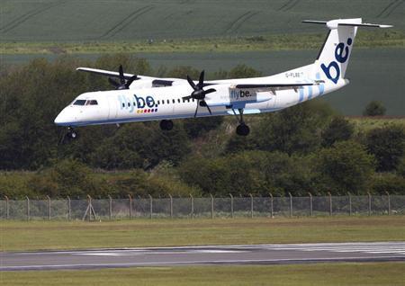 A Flybe aircraft lands at Edinburgh Airport in Scotland May 24, 2011. REUTERS/David Moir