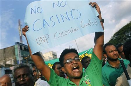 A demonstrator from Sri Lanka's main opposition party United National Party (UNP) shouts slogans against the impending casino business venture in Colombo, November 7, 2013. REUTERS/Dinuka Liyanawatte