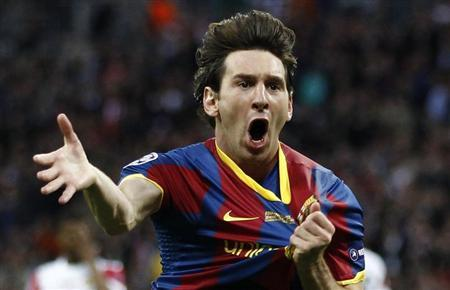 Barcelona's Lionel Messi celebrates after scoring against Manchester United during their Champions League final soccer match at Wembley Stadium in London May 28, 2011. REUTERS/Eddie Keogh