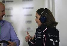 Williams Formula One acting team principal Claire Williams speaks to an unidentified man (L) during the second practice session of the Chinese F1 Grand Prix at the Shanghai International circuit, April 12, 2013. REUTERS/Kim Kyung-Hoon