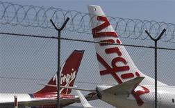 Virgin planes are parked next to each other at Kingsford Smith airport in Sydney August 30, 2013. REUTERS/Daniel Munoz