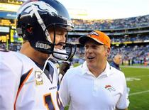 San Diego, CA, USA; Denver Broncos quarterback Peyton Manning (18) celebrates with Denver Broncos interim head coach Jack Del Rio following a win against the San Diego Chargers at Qualcomm Stadium. The Broncos won 28-20. Mandatory Credit: Christopher Hanewinckel-USA TODAY Sports