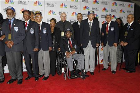 Former members of The Tuskegee Airmen, a group of African American pilots who fought in World War II, arrive as guests at the 43rd NAACP Image Awards in Los Angeles, California in this February 17, 2012 file photo. REUTERS/Fred Prouser/Files