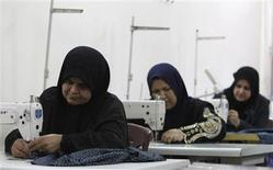 Widows work on sewing machines at a widows' training and development centre in Baghdad in this November 13, 2012 file photo. REUTERS/Saad Shalash/Files