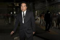 Birmingham City president Carson Yeung Ka Sing leaves the district court in Hong Kong October 15,2013. Yeung has defended himself in the District Court against charges of laundering US$93 million. REUTERS/Tyrone Siu