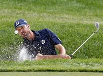 Matt Kuchar of the U.S. hits from the sand on the 16th hole during the third round of the Memorial Tournament at Muirfield Village Golf Club in Dublin, Ohio June 1, 2013. REUTERS/Matt Sullivan