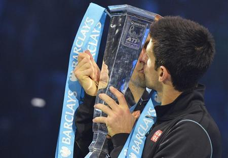 Novak Djokovic of Serbia kisses the trophy after defeating Rafael Nadal of Spain in their men's final singles tennis match at the ATP World Tour Finals at the O2 Arena in London November 11, 2013. REUTERS/Toby Melville