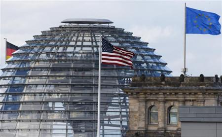 The flag on the U.S. embassy is pictured next to the Reichstag building, seat of the German lower house of parliament Bundestag, in Berlin October 28, 2013. REUTERS/Tobias Schwarz