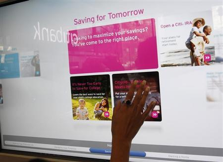 An interactive sales wall is seen at Citi's new flagship branch at Union Square in New York, December 16, 2010. REUTERS/Shannon Stapleton