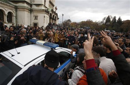 Protesters try to block a police vehicle during a demonstration near the parliament in central Sofia November 12, 2013. REUTERS-Stoyan Nenov