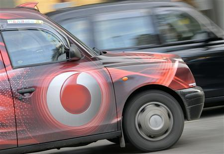 Vodafone branding is seen on the side of a London taxi in London November 12, 2013. REUTERS/Toby Melville