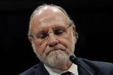 Former MF Global CEO Jon Corzine frowns as he testifies before a House Financial Services Committee Oversight and Investigations Subcommittee hearing on the collapse of MF Global, at the U.S. Capitol in Washington, December 15, 2011. REUTERS/Jonathan Ernst