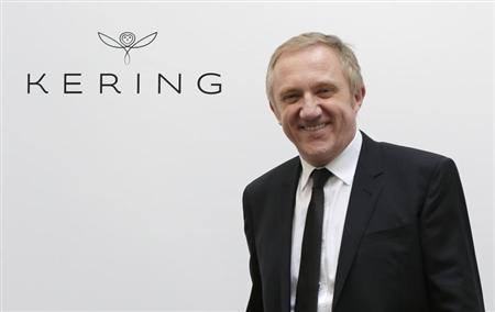 Francois-Henri Pinault, Chairman and CEO of Kering, the new identity of Pinault-Printemps-Redoute (PPR) group, poses next to the logo 'Kering' after a news conference in Paris March 22, 2013. REUTERS/Jacky Naegelen