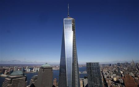 The One World Trade Center tower is seen in this picture taken from the 57th floor of the soon to be opened 4 World Trade Center tower in New York during a press tour, November 8, 2013. REUTERS/Mike Segar