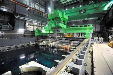 Crane units are installed over the spent fuel pool inside the No.4 reactor building at the tsunami-crippled Tokyo Electric Power Co's (TEPCO) Fukushima Daiichi nuclear power plant in Fukushima prefecture in this November 6, 2013 file photo released by Kyodo. REUTERS-Kyodo-Files
