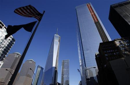 One World Trade Center tower and the soon to be opened 4 World Trade Center tower (R) are seen in New York, November 8, 2013. REUTERS/Mike Segar